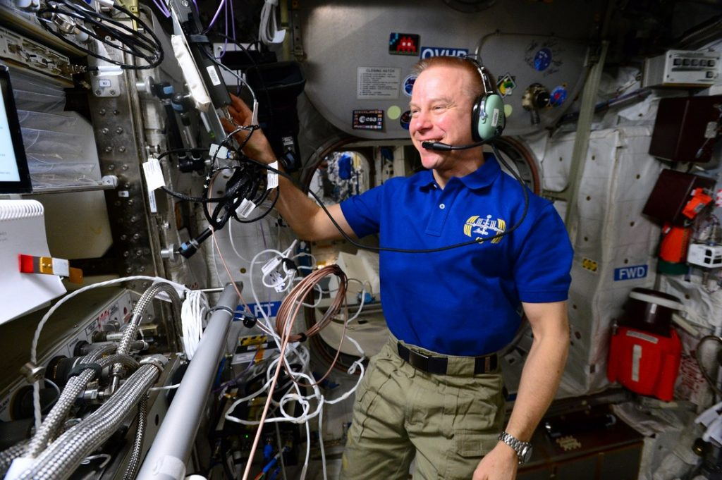 Astronaut aboard International Space Station communicating with students via Amateur Radio ARISS